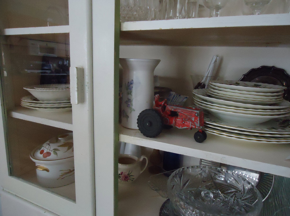 Toy tractor in china cabinet